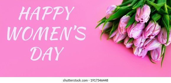 Happy women's day text near a bunch of roses. Banner