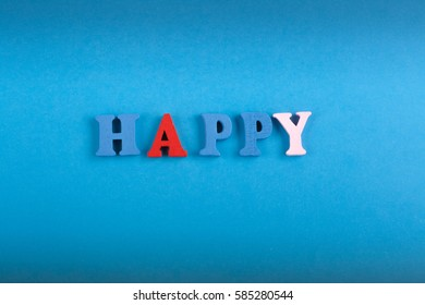 HAPPY word on blue background composed from colorful abc alphabet block wooden letters, copy space for ad text. Learning english concept.