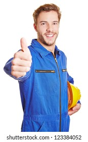 Happy worker in blue overall with hardhat holding his thumbs up