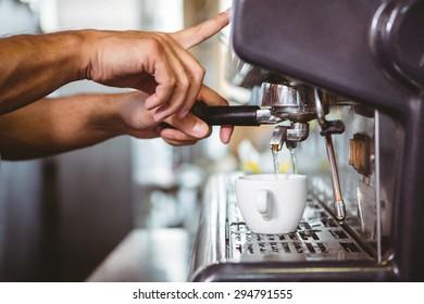 happy worker making coffee in the bakery