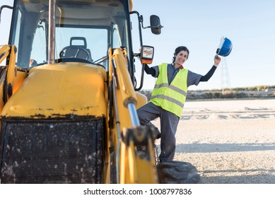 Happy worker woman on heavy vehicle ready for work