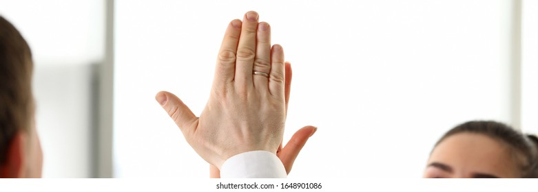 Happy workers in office celebrating new corporate achievement by giving joint high five in air close-up