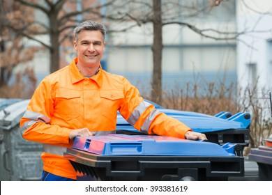 Happy Working Man Standing Near Dustbin On Street