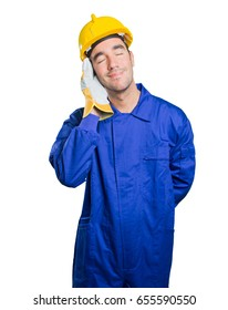 Happy workman sleeping on white background