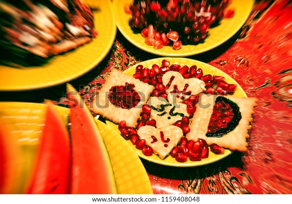 Happy Yalda decoration on biscuits with pomegranate and watermelon