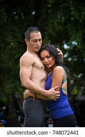 Happy yoga couple hugging with full love at outdoor.