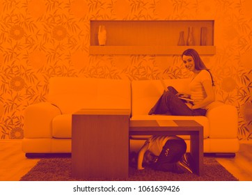happy youg family relaxing in modern livingroom at home duo tone