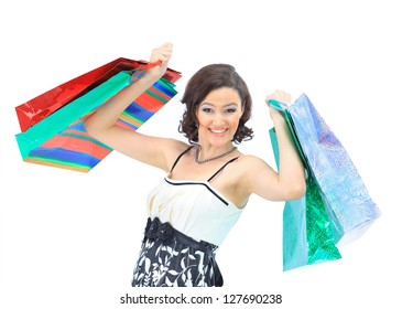 Happy young adult girl, with color-coded bags.