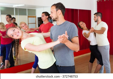 Happy young adults having dance class at studio. Selective focus