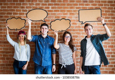 Happy young adults holding up copyspace placard thought bubbles