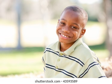 Happy Young African American Boy in the Park.
