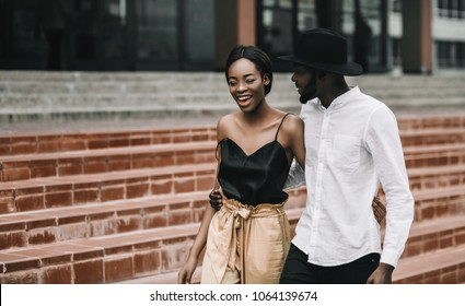 Happy young African American  couple. Black stylish people on street, happiness and communication concept