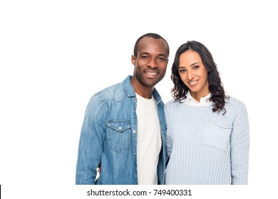 happy young african american couple smiling at camera isolated on white