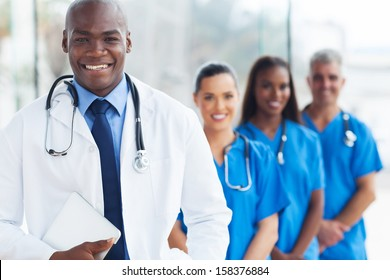 happy young african american doctor and colleagues