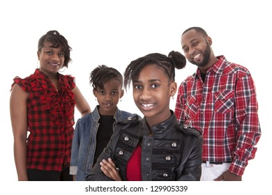 happy young African American family of four on white background