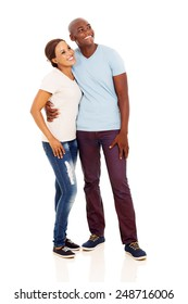 happy young african couple looking up isolated on white background