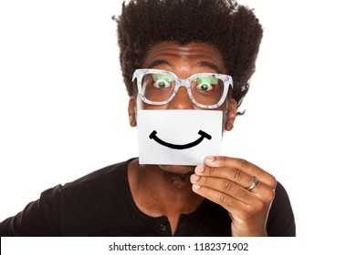 Happy young african man with smile, drawn on sheet of paper on white background