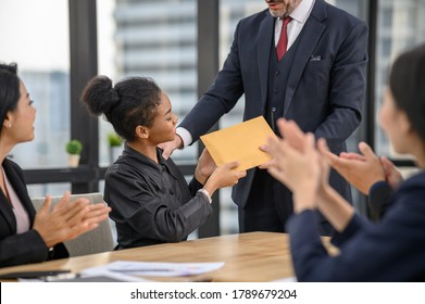Happy young African woman employee excited by unexpected money bonus in envelope from boss, black person rewarded for high work results, praised for successful project completion. Achievement concept