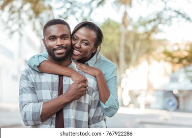 happy-young-african-woman-hugging-260nw-