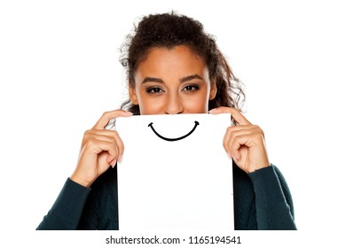 Happy young african woman with smile, drawn on sheet of paper on white background