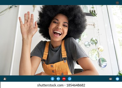 Happy young african woman waving hand saying hi looking at webcam talking to camera making video conference call virtual meeting distance friend, headshot portrait. Videocall screenshot. Web cam view
