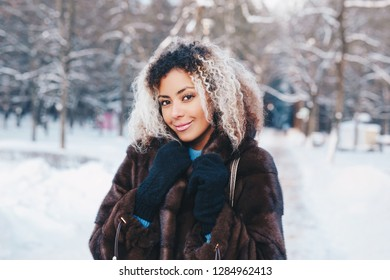 Happy young afro american woman walking in winter time