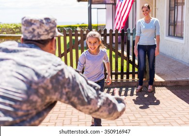 happy young american military family reunion