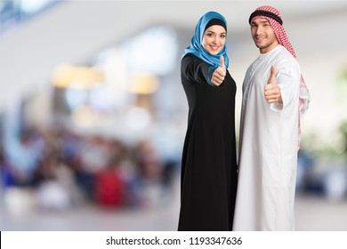 Happy Young Arab Couple  with thumbs up