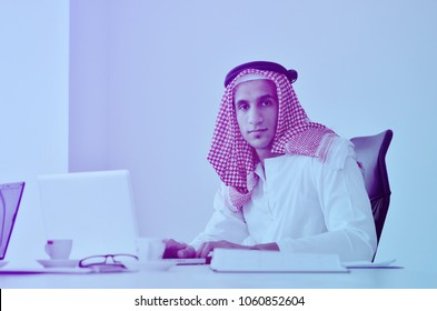 happy young arabic business man working at bright office