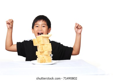 Happy young asian boy with bread