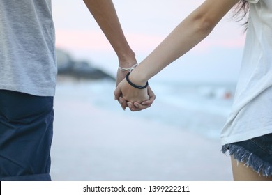 happy young asian couple holding hands . Boyfriend and girlfriend walking and relationship concept