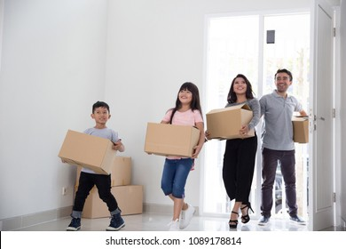 happy young asian family moving to a new house