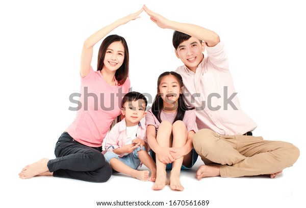 happy young asian family sitting on floor with home concept