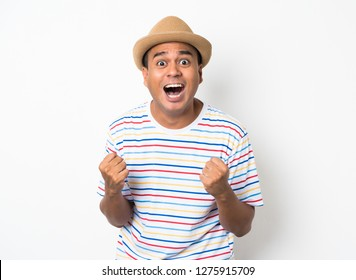 Happy young asian man celebrates with two hand on isolate white background.