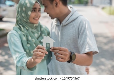 happy young asian muslim couple about having a new house