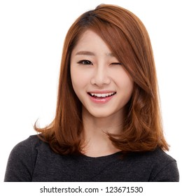 Happy young Asian woman close up shot.