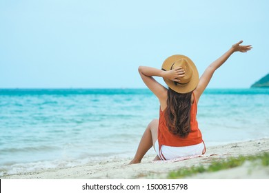 Happy young asian woman enjoy summer vacation on the tropical beach.