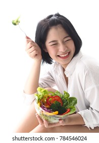 'Happy young Asian woman with fresh vegetable and fresh fruit,healthy concept.