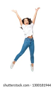 Happy young asian woman jumping up with raised hands isolated on white