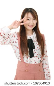 Happy young asian woman showing the peace sign