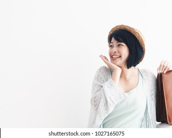 Happy Young Asian woman With vintage brown luggage standing over white background,copy space,Asian travel concept.