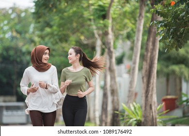 happy young asian women working on exercise and warm up to jogging and running outdoors