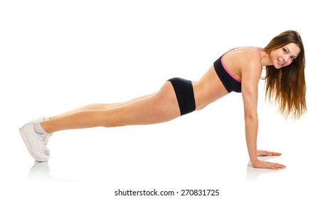 Happy young athletic woman doing sport exercise