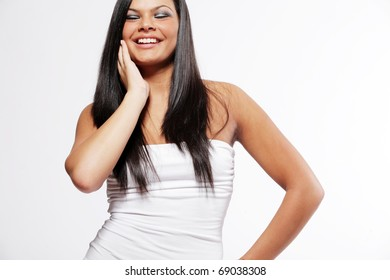 Happy young attractive woman with long black hair.