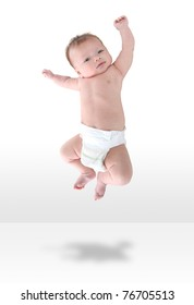 A happy young baby infant jumping for joy