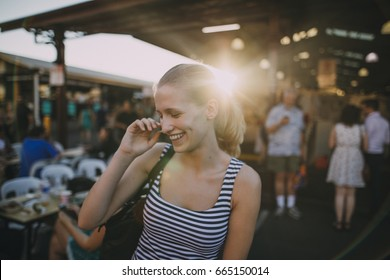 Happy young backpacker is exploring Queen Victoria Market in Australia