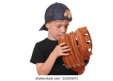 Happy young baseball boy on white background