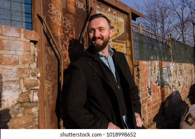 happy young bearded man on sunny day