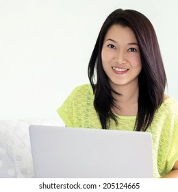 Happy young beautiful asian woman using laptop, Indoors.