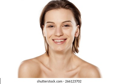 Happy young beautiful girl without make up on white background